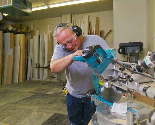 professional carpenter using mitre saw